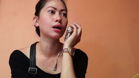 Lady uses cell phone to communicate at home. Laguna, Philippines - August 2, 2015: Lady uses cell phone to communicate at home stock video footage