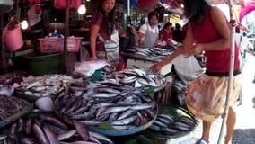 Fish vendor sells fish at flea market. Laguna, Philippines - December 1, 2014: Fish vendor sells fish at flea market stock video
