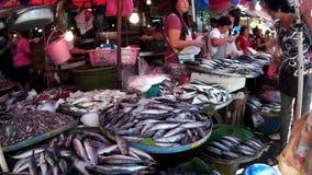 Fish vendor sells fish at flea market. Laguna, Philippines - December 1, 2014: Fish vendor sells fish at flea market stock video footage