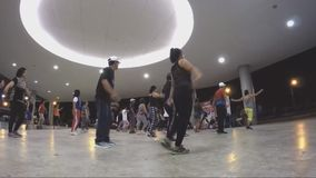 Women perform Zumba indoors stock video footage