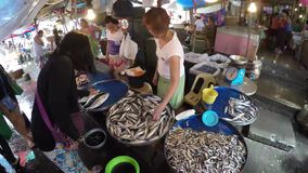 Asian woman buying fish at stall wet market. Laguna, Philippines - February 29, 2016: Asian woman buying fish catch at stall wet market stock footage