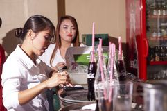 Waitress serving food orders in a restaurant stock photo