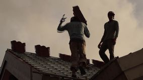 Construction workman carry concrete roof tiles up in the canopy. silhouettes stock footage