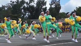 Calisthenics dancers in active performance. Laguna, Philippines - November 21, 2015: public elementary grade school pupils perform dance exercise training for stock footage