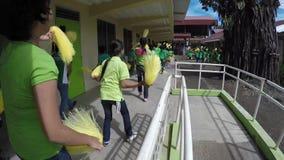 School children perform pom poms calisthenics. Laguna, Philippines - September 3, 2015: Public elementary grade school pupils perform dance exercise, a yearly stock video