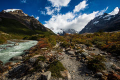 Laguna Torre Trail. Scenery along the way to Laguna Torre. Beautiful fall colors start to show up. Cerro Torre's peaks are covered in clouds Royalty Free Stock Photo
