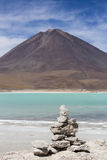 Laguna Verde with blue sky and pile of stones, Bolivia Royalty Free Stock Photography