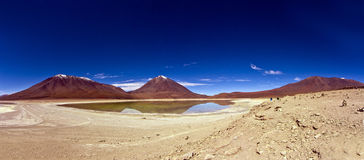 Laguna Verde, Bolivia. Panorama of the Green Lagoon, Bolivia, as seen from its borders, with the Licancabur Volcano on the background Stock Photo