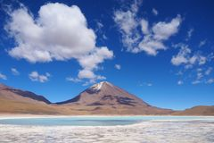 Laguna Verde in Bolivia with scenic clouds stock images