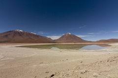 Laguna verde. The green lagoon (Laguna Verde, in Spanish) with the Licancabur volcano on the background marking the border between Bolivia and Chile Royalty Free Stock Images