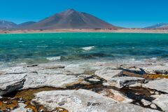 Laguna Verde green water lagoon lake and volcano in Chile mountains of Altiplano