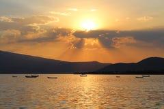 Lagune de coucher du soleil Photographie stock