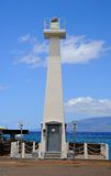 Lahaina Lighthouse. Lahaina, Hawaii, USA-  May 27, 2011This is the small lighthouse that is located in the harbor of Lahaina, Maui.  There is a small boat in the Stock Images