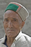 Keylong, Northern India, portrait of a local Himachali man wearing a pahari topi. Portrait of Himachali man in traditional pahari topi hat in Keylong, Lahaul and Stock Photos