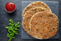 Lahmacun traditional turkish pizza with minced beef or lamb meat, paprika, tomatoes, cumin spice Stock Image