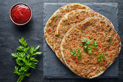 Lahmacun traditional turkish pizza with minced beef or lamb meat, paprika tomatoes, parsley baked spicy food Royalty Free Stock Image