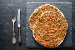 Lahmacun traditional turkish pizza with minced beef meat, paprika tomatoes, parsley Stock Image