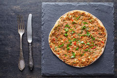 Lahmacun traditional turkish pizza with minced meat, paprika tomatoes, parsley baked spicy food Stock Image