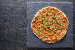 Lahmacun turkish gourmet pizza with minced beef or lamb meat, paprika, tomatoes Royalty Free Stock Photography