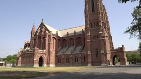 Lahore Cathedral Church of The Resurrection 97. Lahore Anglican Cathedral Church of The Resurrection Side View at Mall Road on a Sunny Blue Sky Day stock footage