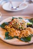 Lahpet is Burmese Tea Leaf Salad served with deep fried garlic, peanut, white sesame, dried shrimp, ginger and roasted coconut.  stock photos
