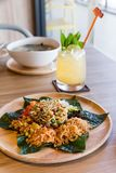 Lahpet is Burmese Tea Leaf Salad served with deep fried garlic, peanut, white sesame, dried shrimp, ginger and roasted coconut.  stock photography