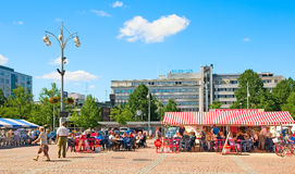Lahti. Finland. People on Market Square. LAHTI, FINLAND - JULY 17, 2010: People rest and eat in cafes on Market Square in the center of Lahti. On the background Royalty Free Stock Photography