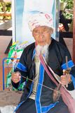 Lahu hilltribe man playing a string instrument in Chiang Rai province, Thailand. Chiang Rai, Thailand - December 10th 2014: Lahu hilltribe man playing a string stock images