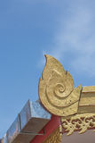 Lai thai pattern on the roof of building in the temple public location in thailand with blue sky background Stock Photos