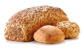 Laib des Brotes und der Rollen getrennt auf Weiß Lizenzfreies Stockbild