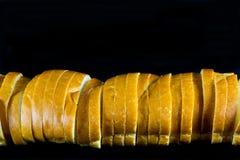 Laib des geschnittenen Brotes Stockbilder