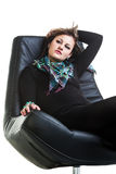Laid back on the leather Stock Image