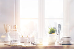 Laid brown kitchen talbe, window toned. Laid brown kitchen talbe with white kitchenware, utencils and a large window in the background. 3d rendering toned image Royalty Free Stock Image