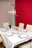Laid dining table. In modern room of house stock photos