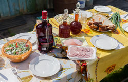 Laid dining table in the garden during the summer sunny day Stock Photos