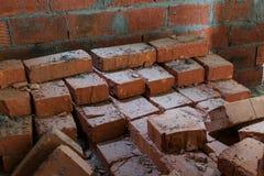 Laid on each other old, damaged bricks. Laid on each other old, damaged, red bricks Stock Images