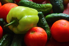Laid fresh whole vegetables. Washed decomposed whole tomatoes, cucumbers, peppers are ready to eat Stock Photo