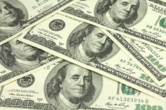 Laid out in the bill hundred American dollars background Stock Images