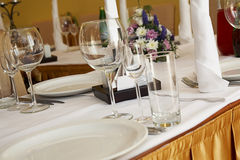 Laid out table. In restaurant - glasses, plates, crockery Royalty Free Stock Images