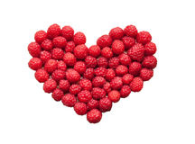 Laid raspberries in a heart shape isolated Stock Photo