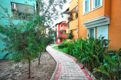 Laid-stone walkway between colorful houses Royalty Free Stock Photos