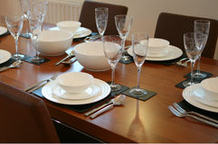 Laid Table. Mahogany table laid out for meal stock images