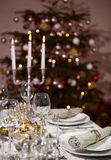 Laid table christmas tree vertical format Stock Photo