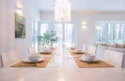 Laid table in dining room Royalty Free Stock Images