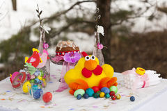 Laid table for Easter: toy chicken with colorful Easter eggs Stock Photo