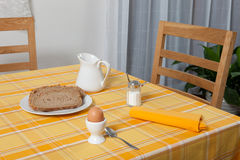 Laid table -  fork and spoon laid on yellow and orange cloth and white plate Stock Photography