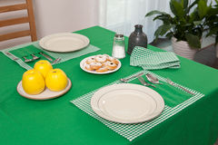 Laid table in green colour Stock Photo