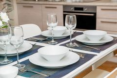The laid table in hotel kitchen stock photography