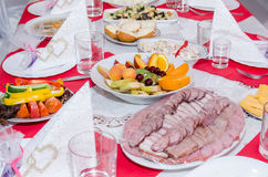 Laid table with many dishes Stock Photo