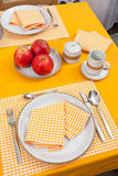 Laid table in orange colour Royalty Free Stock Image